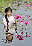 Sum Thida, 12,  harvests water lilies (Nymphaea nouchali) from a pond in Soepreng, a village in the Kampot region of Cambodia. Her family uses the stalk of the plant in soups.