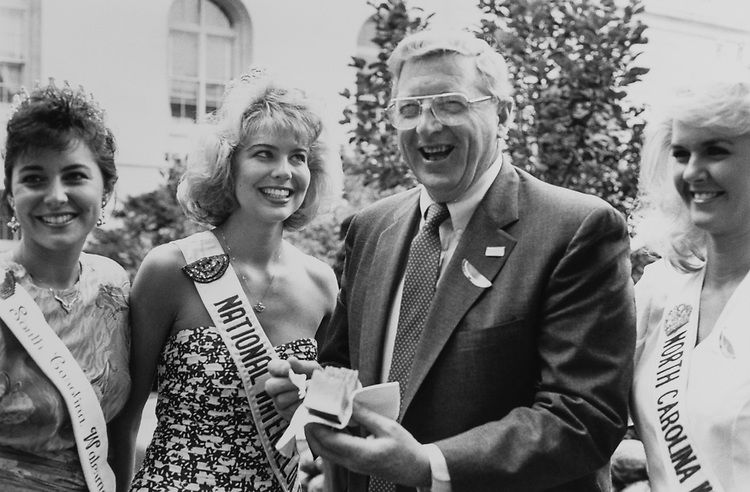 Sen. Conrad Burns, R-Mont., with National Watermelon Queen Pam Mizzell and Queen Janice Dukes and Queen Jan Walters at watermelon feast on July 10, 1991. (Photo by Jamie Howren/CQ Roll Call via Getty Images)