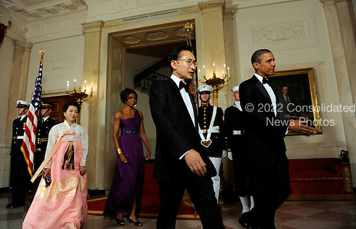 United States President Barack Obama and First Lady Michelle Obama walk with South Korean President Lee Myung-bak and Lee's wife Kim Yoon-ok in the Cross Hall as they arrive for a State Dinner at the White House in Washington, DC on Thursday, October 13, 2011. The State Visit comes only a day after Congress passed a free trade agreement with South Korea.  .Credit: Roger L. Wollenberg / Pool via CNP