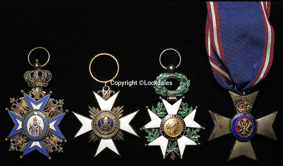 BNPS.co.uk (01202 558833)<br /> Pic: Lockdales/BNPS<br /> <br /> (L to R) Order of St. Sava,Order of Saint Sylvester 1905, Officer de la Legion d-Honneur and The Royal Victorian Order; Member's Badge.<br /> <br /> The little-known tale of the original British spy codenamed 'M', a role made famous by the James Bond films, has been revealed after his service medals emerged for sale.<br /> <br /> Former police detective William Melville used the legendary cryptonym while reporting back to the War Office in the early 1900s before becoming the first chief of the British Secret Service Bureau.<br /> <br /> Melville, who hunted Jack the Ripper before becoming a spy, would sign top secret documents with the first letter of his surname - 'M' - while working for the forerunners of intelligence agencies MI5 and MI6.<br /> <br /> The memorabilia will go under the hammer with an estimate of £1,200 on November 19.