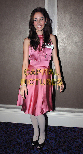 MISS El Salvador, ELENA BARDI .attending a photocall for the contestants of Miss World 2009 at Grosvenor House, London, England, UK, .November 9th 2009. .full length pink sleeveless dress grey gray white tights silk satin black peep toe shoes .CAP/IA.©Ian Allis/Capital Pictures.