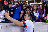 HOUSTON, TX - FEBRUARY 03: Tobin Heath #17 of the United States takes a selfie with a fan during a game between Costa Rica and USWNT at BBVA Stadium on February 03, 2020 in Houston, Texas.