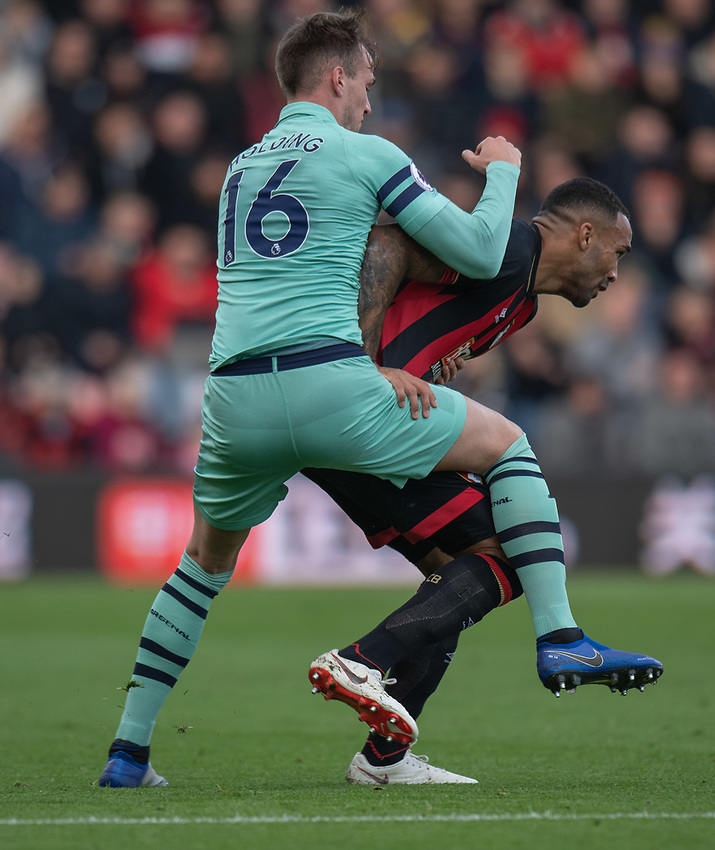 Bournemouth's Callum Wilson (right) is tackled by Arsenal's Rob Holding (left) <br /> <br /> Photographer David Horton/CameraSport<br /> <br /> The Premier League - Bournemouth v Arsenal - Sunday 25th November 2018 - Vitality Stadium - Bournemouth<br /> <br /> World Copyright © 2018 CameraSport. All rights reserved. 43 Linden Ave. Countesthorpe. Leicester. England. LE8 5PG - Tel: +44 (0) 116 277 4147 - admin@camerasport.com - www.camerasport.com