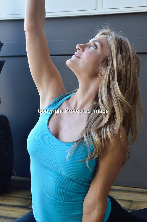 stock photo of woman at yoga studio