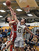 George Mansour #45 of Northport, right, contests a drive to the net by Ryan Vaughn #3 of Connetquot during the first quarter of Suffolk II boys basketball game at Northport High School on Wednesday, Jan. 9, 2019. Mansour scored scored 10 of his 14 points in the fourth quarter. Northport won by a score of 62-48.
