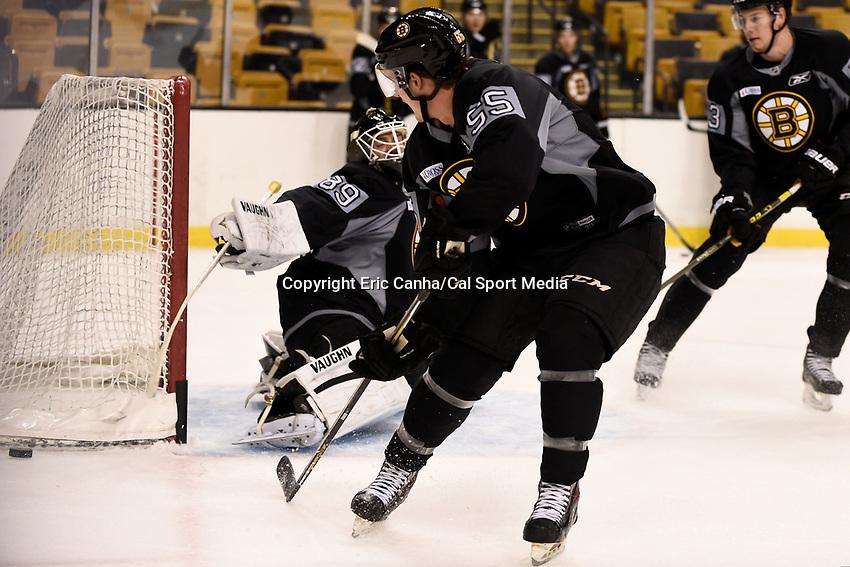 September 18, 2015 - Boston, Massachusetts, U.S. - Boston Bruins goalie Jonas Gustavsson (89) deflects a shot by forward Noel Acciari (55) during the Boston Bruins training camp held at TD Garden in Boston Massachusetts. Eric Canha/CSM