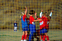 "Young girls' soccer team giving """"high five"