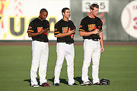 Rochester Red Wings Jacque Jones (11), Jason Repko (2), and Dustin Martin (16) stand for the National Anthem before a game vs. the Louisville Bats Friday, May 14, 2010 at Frontier Field in Rochester, New York.   Rochester defeated Louisville by the score of 13-4.  Photo By Mike Janes/Four Seam Images