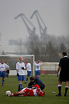 Tranmere Rovers Ladies 5 Middlesbrough Ladies 0, 22/01/2006. FA Women's premier League North. Tranmere Rovers Ladies (white) take on Middlesbrough Ladies in a FA Women's premier League (North) match at Poulton Victoria FC's ground in Wallasey with Birkenhead docks cranes in the background. Picture shows a Boro player receiving treatment. Rovers won 5-0.<br />  Photo by Colin McPherson.