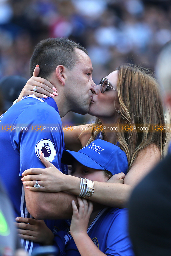 An emotional kiss from Toni Terry, wife of John Terry after his goodbye speech on the pitch during Chelsea vs Sunderland AFC, Premier League Football at Stamford Bridge on 21st May 2017