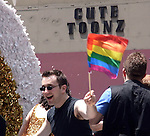 ©2009 David Burnett / Contact Press Images.NY: 212-695 7750.June 28, 2009..Jordan Kai Burnett ,  on the Stonewall float, 2009 Gay Pride Parade New York City.Senator Chuck Schumer.