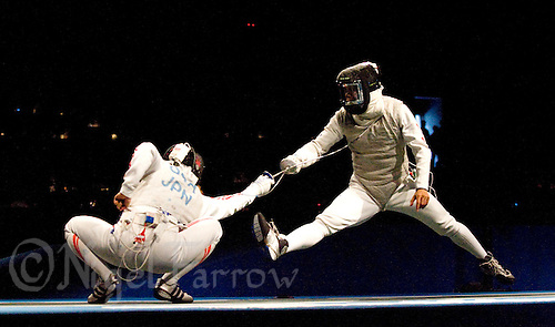 13 AUG 2008 - BEIJING, CHN - Yuki Ota (JPN) v Byungchul Choi (KOR) - Mens Individual Foil heat - Beijing Olympics. (PHOTO (C) NIGEL FARROW) *** IOC RULES APPLY ON USAGE ***