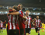 Harry Chapman of Sheffield Utd is mobbed after scoring during the League One match at Bramall Lane Stadium, Sheffield. Picture date: September 27th, 2016. Pic Simon Bellis/Sportimage