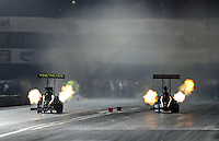 Nov 13, 2010; Pomona, CA, USA; NHRA top fuel dragster driver Morgan Lucas (left) races alongside Steve Torrence during qualifying for the Auto Club Finals at Auto Club Raceway at Pomona. Mandatory Credit: Mark J. Rebilas-