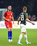 England's Jordan Henderson has words with Germany's Toni Kroos during the International Friendly match at Olympiastadion.  Photo credit should read: David Klein/Sportimage