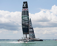25 July 2015: Land Rover BAR in flight during the America's Cup first round racing off Portsmouth, England (Photo by Rob Munro)