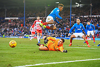 Doncaster Rovers  keeper Marko Marosi makes a save from Jamal Lowe of Portsmouth during Portsmouth vs Doncaster Rovers, Sky Bet EFL League 1 Football at Fratton Park on 2nd February 2019