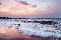 Waves crashing on Negombo Beach at sunset, West Coast of Sri Lanka, Asia. This is a photo of waves crashing on Negombo Beach at sunset, West Coast of Sri Lanka, Asia.