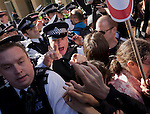 15/10/2011. LONDON, UK. Police scuffle with Occupy London protesters at an entrance to Paternoster Square during the Occupy London protest.