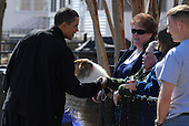 United States President Barack Obama shakes hands with an unidentified military family as he departs the physical fitness building after a morning of basketball at the Fort McNair facility, to return to the White House in Washington, DC, USA, USA, Sunday, 07 March 2010.  Obama is to make remarks on the elections in Iraq later in the day..Credit: Mike Theiler / Pool via CNP