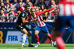 Antoine Griezmann (r) of Atletico de Madrid fights for the ball with Clement Nicolas Laurent Lenglet of Sevilla FC during the La Liga 2017-18 match between Atletico de Madrid and Sevilla FC at the Wanda Metropolitano on 23 September 2017 in Wanda Metropolitano, Madrid, Spain. Photo by Diego Gonzalez / Power Sport Images