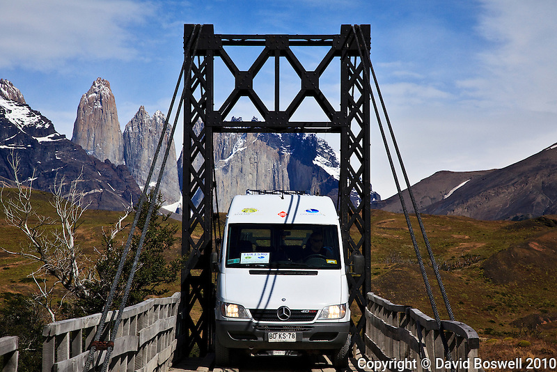 A mini-bus finds it a tight fit in Torres del Paine National Park, Chile.