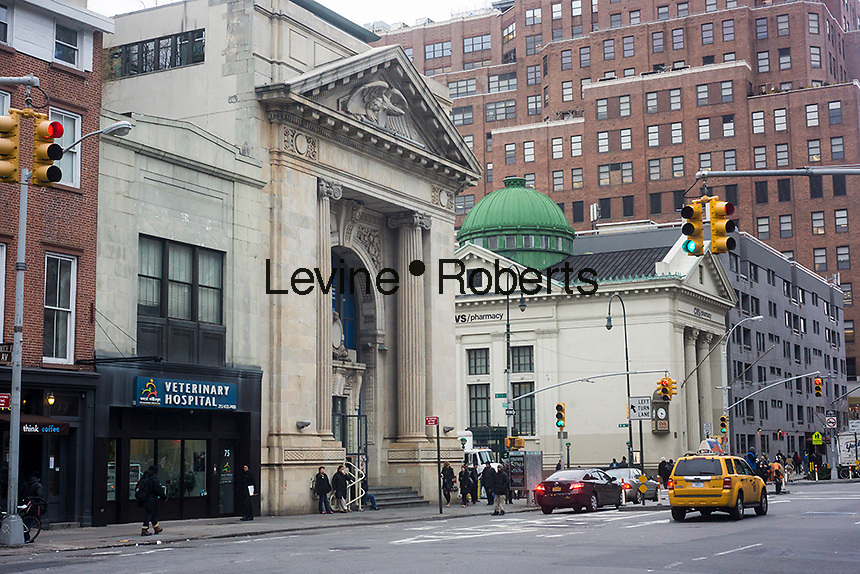 The former New York County Bank, built in 1906, left, and the former New York Savings Bank, right, built in 1897 now respectively a spa and a CVS drugstore are seen in the Chelsea neighborhood of New York on Thursday, January 17, 2013. The buildings went through several uses after they were de-banked finally arriving at their final tenancy. (© Richard B. Levine)