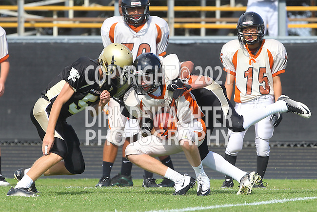 Palos Verdes, CA 09/22/11 - unknown Beverly Hills player(s), Max MacLeay (Peninsula #5) and Marco Catallo (Peninsula #10)) in action during the Beverly Hills-Peninsula Varsitty Football gane.