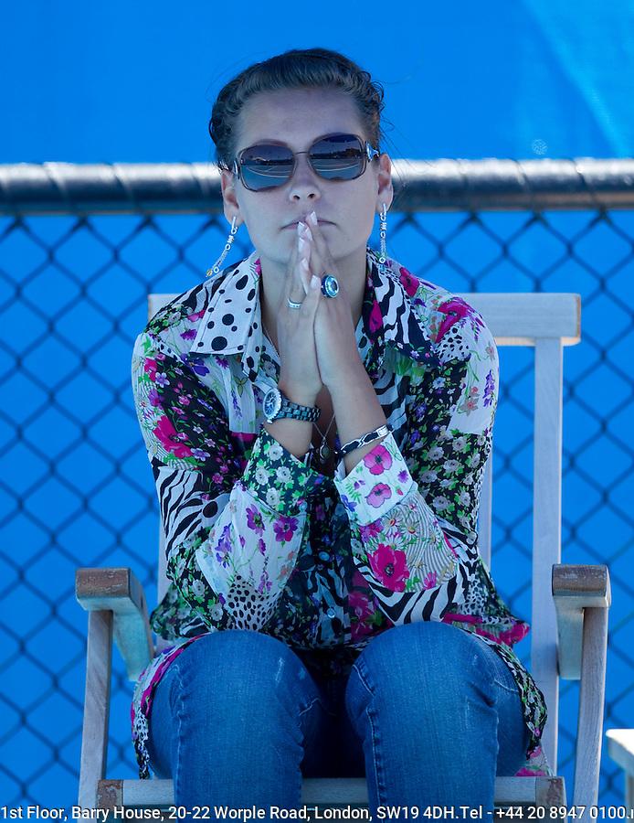 Erina Davydenko watching her husband Nicolay Davydenko on the practice court..International Tennis - Australian Open Tennis -  Tues 26  Jan 2010 - Melbourne Park - Melbourne - Australia ..© Frey - AMN Images, 1st Floor, Barry House, 20-22 Worple Road, London, SW19 4DH.Tel - +44 20 8947 0100.mfrey@advantagemedianet.com