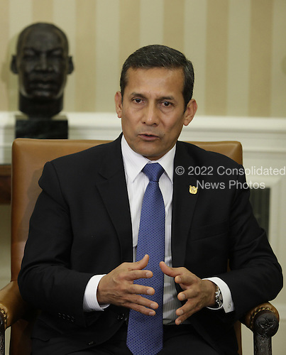 President Ollanta Humala of Peru talks to the media during a meeting with United States President Barack Obama in the Oval Office of the White House in Washington, DC on June 11, 2013.  <br /> Credit: Yuri Gripas / Pool via CNP