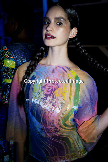 JOHANNESBURG, SOUTH AFRICA MARCH 20: A model walking for the South African designer Marianne Fassler waits backstage before a show at Mercedes Benz Africa fashion autumn/ winter 2014 week on March 20, 2014 held in Johannesburg, South Africa. South African designers showed their best fall/winter collections. (Photo by: Per-Anders Pettersson)