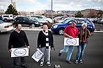 From left, David Muegge, Malia Stoner, Chris Miller, and Jaclyn Miller line up early to see GOP presidential candidate Newt Gingrich at a campaign event at Great Basin Brewing Company in Reno, Nevada, February 1, 2012.