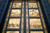 Religious scenes in gold on bronze on the Baptistry doors of Il Duomo di Firenze, Cathedral of Florence, in Piazza di San Giovanni, Italy