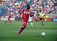 Chicago forward Patrick Nyarko (14) dribbles down the field.  The Chicago Fire defeated Toronto FC 2-0 at Toyota Park in Bridgeview, IL on August 21, 2011.