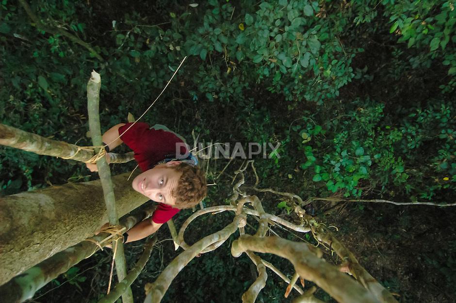 Bat researcher Matt Struebig climbs into the forest canopy east of Lake Tebo, Sangkulirang, East Kalimantan, during a Rapid Ecological Assessment.