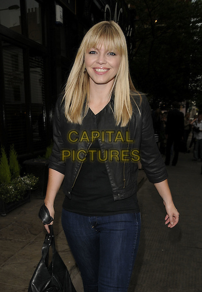 KATE THORNTON.The Neville Hair & Beauty salon relaunch party, Pont St., London, England..June 22nd, 2009.half length black leather jacket jeans denim .CAP/CAN.©Can Nguyen/Capital Pictures.