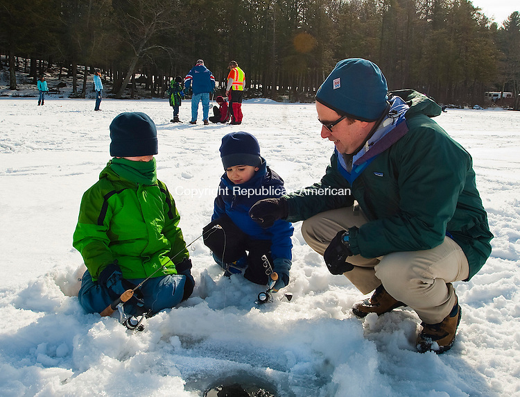 TORRINGTON, CT-020114JS03- Robert Klee, the new state Department of Energy and Environmental Services commissioner,  spends some time ice fishing with his sons Alexander, 6 and Jacob, 4. <br />  during the eighth annual Winter festival at Burr Pond State Park in Torrington on Saturday. The event was hosted by the DEEP as part of their No Child Left Inside program. <br /> Jim Shannon Republican-American