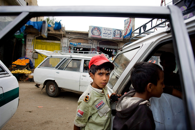 Children at a shared taxi stand in Taezz, Yemen, Nov. 30, 2009. Shared taxis and mini buses are cheap forms of local transportation in Yemen. Lawlessness, growing poverty, a water crisis, a raging conflict with Houthi rebels in Yemen's north and clashes with separatists in the South continue to destabilize the Arabian Peninsula's poorest state.