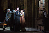 London, UK. 1 October 2016. Keri Alkema as Tosca and Gwyn Hughes Jones as Cavaradossi. Dress rehearsal of the Giacomo Pucccini opera Tosca with Keri Alkema as Floria Tosca, Gwyn Hughes Jones as Mario Cavaradossi and Craig Colclough as Baron Scarpia. Donna Stirrup is the revival director of Catherine Malfitano's original ENO production of Tosca, set design by Frank Philipp Schlössman. 13 performances at the London Coliseum from 3 October to 3 December 2016.