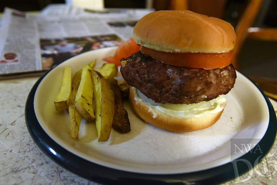 """NWA Democrat-Gazette/FLIP PUTTHOFF<br />Camp See No Deer Blue Cheeseburgers are     Feb. 16 2017     """"Cheeseburgers in Paradise"""" indeed. But where's the cheese? Inside the burger."""