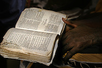 A detainee reads from the Book of Paslms in the Bible at the 'City of Rest', a rudimentary counselling and mini rehabilitation centre for recovering drug addicts, alcoholics and traumatised or delinquent youths.  It is run by a pastor who attributes the centre's success to the extensive rest, food and prayer.  