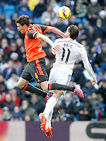 Real Madrid's Garet Bale (r) and Real Sociedad's Gorka Elustondo during La Liga match.January 31,2015. (ALTERPHOTOS/Acero) /NortePhoto<br />