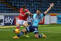 Aaron McGowan of Morcambe clears the ball under pressure from Matthew Bloomfield of Wycombe Wanderers during the Sky Bet League 2 match between Wycombe Wanderers and Morecambe at Adams Park, High Wycombe, England on 12 November 2016. Photo by David Horn.