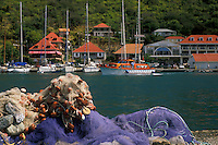 AJ2431, St. Barthelemy, Caribbean, Gustavia, St. Barts, Caribbean Islands, Saint Barts, Fishing nets in the foreground of the scenic harborfront of Gustavia the capital of the island of Saint Barthelemy (a department of Guadeloupe).