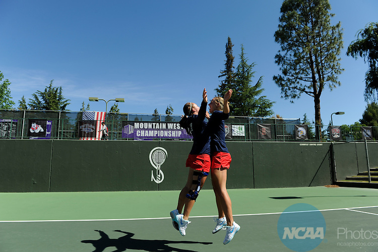 27 APR 2014:  Fresno State University takes on the University of New Mexico during the 2014 Mountain West Conference Women's Tennis Championship held at the Sierra Racquet and Sports Club held in Fresno, CA.  Justin Tafoya/NCAA Photos