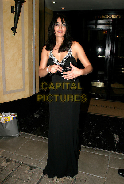 LAILA ROUASS.TV Quick & TV Choice Awards at the Dorchester Hotel, Park Lane, London..September 5th, 2005.full length black dress clutch purse.www.capitalpictures.com.sales@capitalpictures.com.© Capital Pictures.