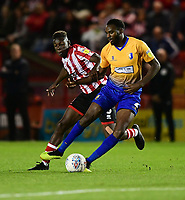 Mansfield Town's Hayden White under pressure from Lincoln City's Bernard Mensah<br /> <br /> Photographer Chris Vaughan/CameraSport<br /> <br /> The EFL Checkatrade Trophy Group H - Lincoln City v Mansfield Town - Tuesday September 4th 2018 - Sincil Bank - Lincoln<br />  <br /> World Copyright © 2018 CameraSport. All rights reserved. 43 Linden Ave. Countesthorpe. Leicester. England. LE8 5PG - Tel: +44 (0) 116 277 4147 - admin@camerasport.com - www.camerasport.com