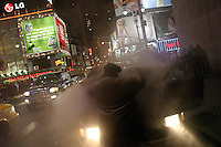 NEW YORK - APRIL 2 : An unidentified man opens the hood of his broken-down mini-van on 45th Street in Times Square, April 2, 2004 in New York City. Times Square's 100th birthday is April 8, 2004. On April 8, 1904, Mayor George McClellan signed a resolution changing the name of Long Acre Square to Times Square. Times Square, a living icon of popular culture, is one of the most familiar and most frequently reproduced fragments of urban real estate on the planet. (Photo by Landon Nordeman 2004)