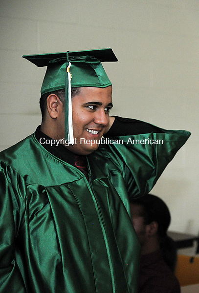 WATERBURY, CT, 24 JUNE 13- 062413AJ07- Nelson Villanueva, who graduated Monday from Wilby High School in Waterbury prepares for the ceremony.  Alec Johnson/ Republican-American