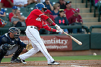 Round Rock Express outfielder Julio Borbon swings #20 during the Pacific Coast League baseball game against the New Orleans Zephyrs on May 2, 2012 at The Dell Diamond in Round Rock, Texas. The Express defeated the Zephyrs 10-5. (Andrew Woolley / Four Seam Images)